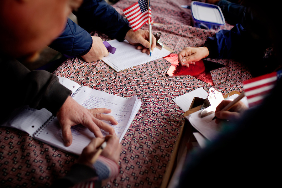 Tea Party Supporters signed handwritten petitions to be mailed to the State's Attorney General asking him to sue the Federal government for the health care bill during a Tea Party Express rally in Sherwood Park, the eighth stop in its 43-city tour across the country. .