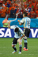 Lionel Messi of Argentina throws his bottle of water on the ground as he celebrates a penalty being scored