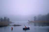 Men fishing on a misty waterway, Southampton, NY