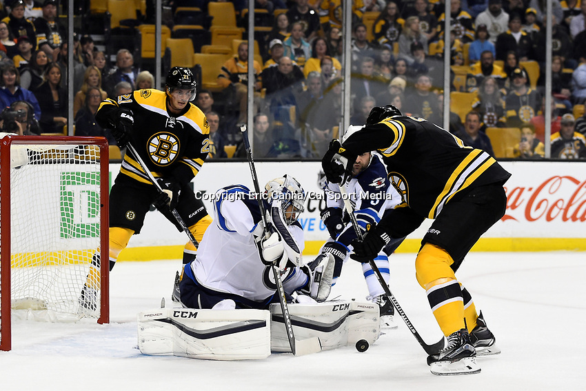 Thursday, October 8, 2015: Winnipeg Jets goalie Ondrej Pavelec (31) and defenseman Mark Stuart (5) work to stop and attack from Boston Bruins right wing Brett Connolly (14) during the NHL game between the Winnipeg Jets and the Boston Bruins held at TD Garden, in Boston, Massachusetts. Winnipeg defeated Boston 6-2 in regulation time. Eric Canha/CSM