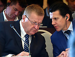 November 29, 2016, Tokyo, Japan - Vice President John Coates, left, of the International Olympic Committee listens to his aide during a four-party meeting to review costs and venues for the 2020 Tokyo Olympics and Paralympics at a Tokyo hotel on Tuesday, November 29, 2016. The four top-level representatives of the IOC, 2020 Games organizers, the Tokyo Metropolitan and Japanese governments discussed details regarding the venues for rowing/canoe and volleyball based on proposals by the metropolitan government.  (Photo by Natsuki Sakai/AFLO) AYF -mis-