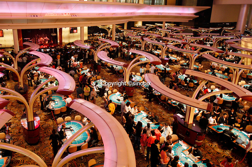 Gamblers at the tables in the Sands Casino in Macau.<br /> May 08, 2007