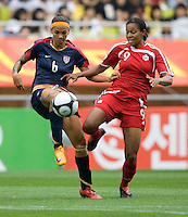 USWNT forward (6) Natasha Kai battles for the ball with Canadian defender (9) Candace Chapman during the finals of the Peace Queen Cup.  The USWNT defeated Canada, 1-0, at Suwon World Cup Stadium in Suwon, South Korea.