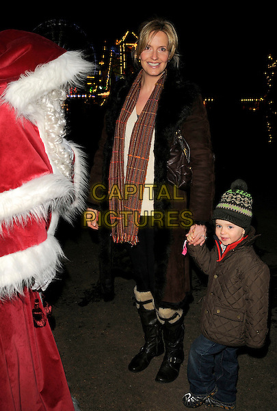 PENNY LANCASTER & ALISTAIR STEWART.The Winter Wonderland launch party, Hyde Park, London, England..Novmber 20th, 2008.full length child family kid son mother mom mum family holding hands brown black coat scarf hat boots .CAP/CAN.©Can Nguyen/Capital Pictures.