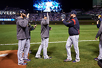Cleveland Indians starting pitcher Corey Kluber (right) high fives teammates before Game 4 of the Major League Baseball World Series against the Chicago Cubs on October 29, 2016 at Wrigley Field in Chicago, Illinois.  (Mike Janes/Four Seam Images)