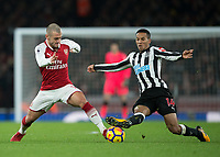 Alexis Sanchez of Arsenal and Isaac Hayden of Newcastle United battle for possession during the Premier League match between Arsenal and Newcastle United at the Emirates Stadium, London, England on 16 December 2017. Photo by Vince  Mignott / PRiME Media Images.