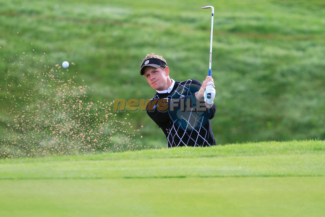 Luke Donald chips out of a greenside bunker at the 15th hole in the Day 2 session of the overnight Fourball Match 4 during Day 1 of the The 2010 Ryder Cup at the Celtic Manor, Newport, Wales, 29th September 2010..(Picture Eoin Clarke/www.golffile.ie)