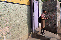 A young schoolgirl stands in her community in a residential district in Kolkata.<br />
