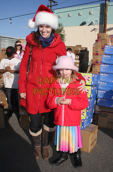 """AMY BRENNEMAN & CHARLOTTE BRENNEMAN.""""The Salvation Army"""" Making Miracle on South Central, Sponsored by Feed The Children and NBPA held at Salvation Army Headquarters,  Los Angeles, CA, USA,  13 December 2008..full length red santa hat xmas christmas daughter .CAP/ADM/KB.©Kevan Brooks/Admedia/Capital PIctures"""