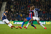 2nd December 2017, The Hawthorns, West Bromwich, England; EPL Premier League football, West Bromwich Albion versus Crystal Palace; Wilfred Zaha of Crystal Palace stretches for the ball as Allan Romeo Nyom and Claudio Yacob of West Bromwich Albion come in to tackle