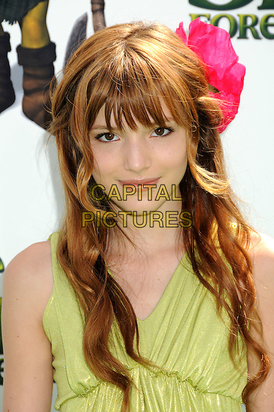 "BELLA THORNE.""Shrek Forever After"" Los Angeles Premiere held at the Gibson Amphitheatre, Universal City, California, USA..May 16th, 2010.headshot portrait fringe bangs green pink flower in hair .CAP/ADM/BP.©Byron Purvis/AdMedia/Capital Pictures."