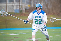Danny Kelly,'17, follows game action as the Seahawks battle Roger Williams in Men's Lacrosse game action at Gaudet Field in Middletown.