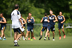 28 May 2012: Head coach Bruce Arena (left) watches his team jog around the field during warmups. The Los Angeles Galaxy held a training session on Field 6 at WakeMed Soccer Park in Cary, NC the day before playing in a 2012 Lamar Hunt U.S. Open Cup third round game.