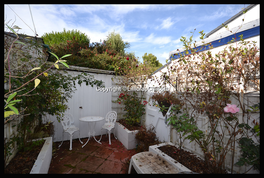 BNPS.co.uk (01202 558833)<br /> Pic: LillicrapChilcott/BNPS<br /> <br /> The patio garden area.<br /> <br /> Next stop Spain!<br /> <br /> A rare chance to own the most southerly house in Britain nestled on a rocky outcrop overlooking the English Channel has arisen - but prospective buyers will have to rustle up &pound;575,000 to get their hands on it.<br /> <br /> The secluded two-bed terraced house would be ideal for those looking to be at one with nature - because it sits on the tip of Bass Point at The Lizard in Cornwall, the most southerly part of mainland Britain.<br /> <br /> Once a coastguard cottage, it offers sweeping 180 degree views of the rugged coastline and is so exposed to the elements its owners say sitting in the lounge feels like being out at sea.<br /> <br /> If you were to travel due south of the house the next land you would hit would be Santander in Spain.