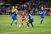 Kansas City, Mo. - Saturday April 23, 2016: Portland Thorns FC midfielder Tobin Heath (17) attempts to dribble past FC Kansas City defender Desiree Scott (3) during a match at Swope Soccer Village. The match ended in a 1-1 draw.