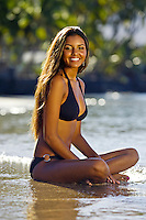 A young woman enjoys the beach at Lahaina, Maui.