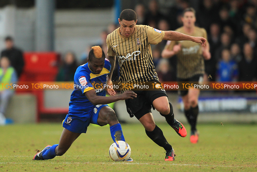 Toby Ajala of AFC Wimbledon and Nathan Doyle of Bradford City - AFC Wimbledon vs Bradford City - NPower League Two Football at the Fans Stadium, Kingsmeadow - 16/02/13 - MANDATORY CREDIT: Simon Roe/TGSPHOTO - Self billing applies where appropriate - 0845 094 6026 - contact@tgsphoto.co.uk - NO UNPAID USE