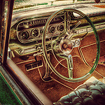 Automobile vintage interior with dashboard and stearing wheel
