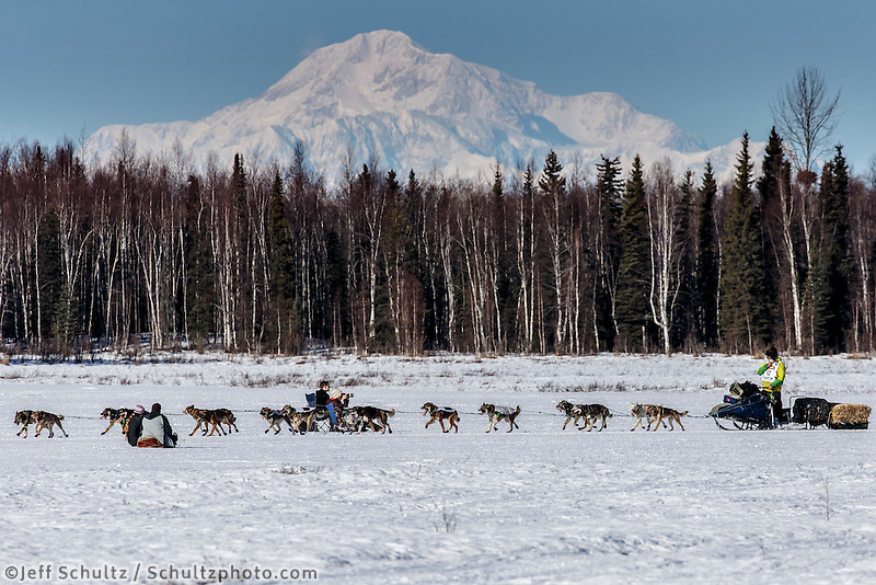 Nicolas Petit runs on Long Lake with Denali in the background during the Restart of the 2016 Iditarod in Willow, Alaska.  March 06, 2016.