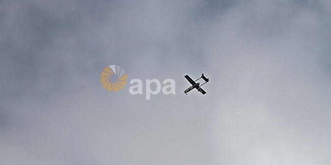 A drone belonging to the Ezzedine al-Qassam Brigades, Hamas' armed wing, flies over Gaza City during a military parade marking the 27th anniversary of Hamas' founding, in Gaza City December 14, 2014. Photo by Mohammed Asad