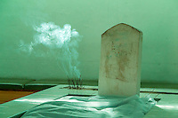 South Africa, Cape Town, Bo-kaap.  Incense Burning at the Tomb (Kramat) of Tuan Sayeed Alawi, died 1803.  Tana Baru Cemetery above Bo-kaap.