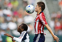 Chivas USA midfielder Jorge Flores goes over the top of New England Revolution forward Sainey Nyassi for a ball. Chivas USA defeated the New England Revolution 2-0 at Home Depot Center stadium in Carson, California on Sunday September 13, 2009...