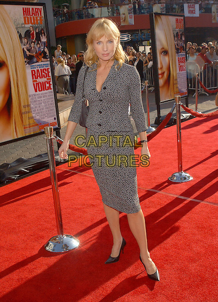 REBECCA DE MORNAY.The New Line Cinema's World Premiere of Raise Your Voice held at The Loews Universal City 18 Theatres in Universal City, California .October 3, 2004.full length, black and white dress, spots, dots.www.capitalpictures.com.sales@captialpictures.com.Copyright 2004 by Debbie VanStory
