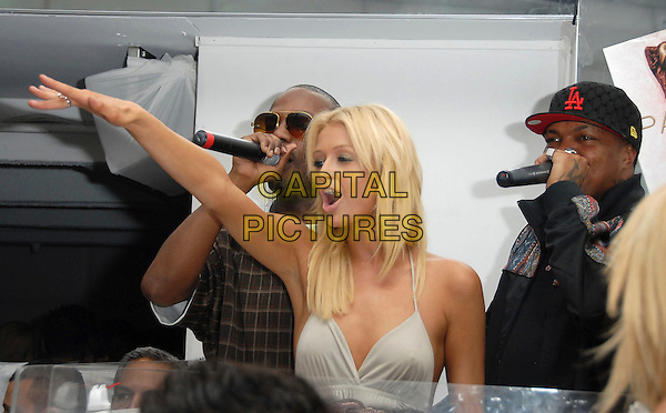 PARIS HILTON & THREE 6 MAFIA.At The Paris Hilton CD Release Party held at Privelege in West Hollywood, California, USA, August 18, 2006..half length grey dress halterneck  six 3 funny dancing arm gesture.Ref: DVS.www.capitalpictures.com.sales@capitalpictures.com.©Debbie VanStory/Capital Pictures