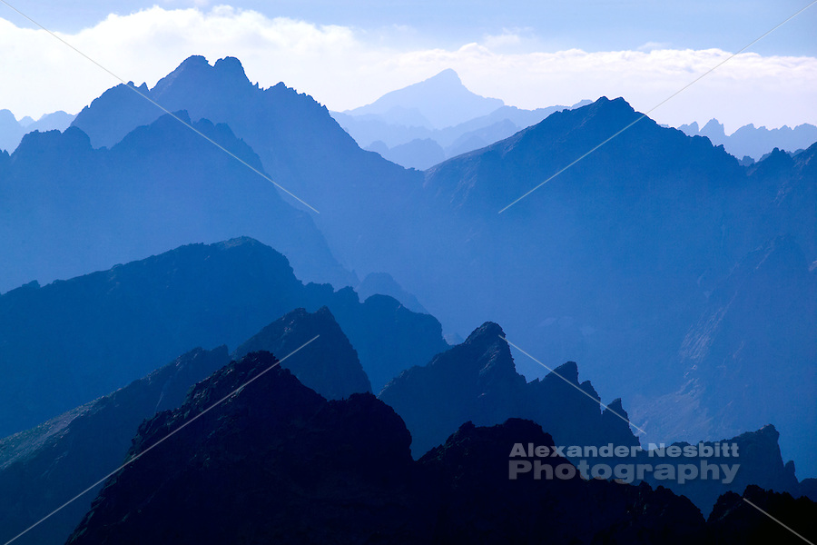 Slovakia, 2006 - The High Tatra mountains fade into the blue high altitude haze.
