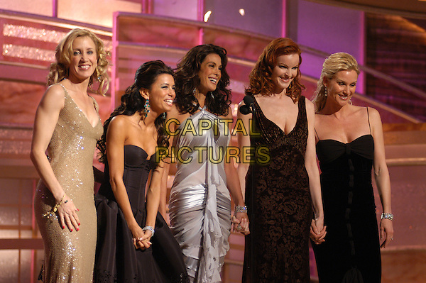 "CAST OF ""DESPERATE HOUSEWIVES"".FELICITY HUFFMAN, EVA LONGORIA. TERI HATCHER, MARCIA CROSS & NICOLLETTE SHERIDAN.62nd  Annual Golden Globe Awards, .Beverly Hilton Hotel, Beverly Hills, .California, USA, 16th January 2005..half length stage show ceremony Nicolette.www.capitalpictures.com.sales@capitalpictures.com.Supplied by Capital Pictures"