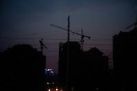 Evening landscape view from a train of a commercial building construction site near the Sānménxiá Shì Húbīn District in Hénán Province.  © LAN