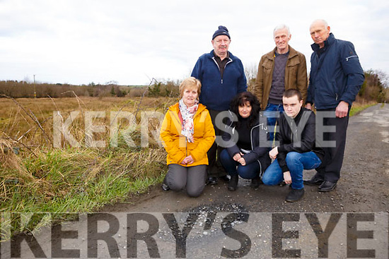 Locals from Fourhane Road about deplorable state of their road in Listowel, showing the state of the road and the dangerous deep potholes,<br /> Kneeing l-r, Kay Heffernan, Ger and Tommy Porter.<br /> Standing l-r, Mike Heffernan, Joe Curtain and John Brosnan.