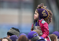 A young fan waits for the Blanket Parade alumni to be let into the stadium before the game.
