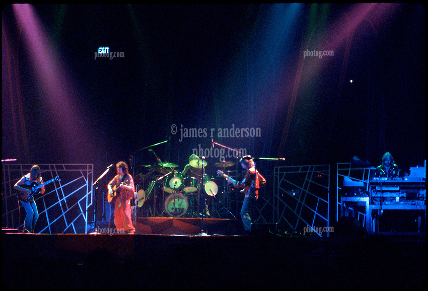 Yes performing at the New Haven Coliseum on 9 August 1977. L-R: Steve Howe, Jon Anderson, Alan White, Chris Squire, and Rick Wakeman. Credit Photograph: James R Anderson, New Haven CT