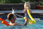 A young girl and her dad play in the pool in Gardnerville, Nev., on June 8, 2008..Photo by Cathleen Allison