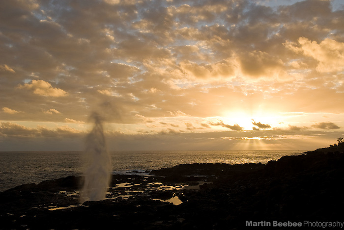 Spouting Horn blowhole at sunset, Kauai, Hawaii