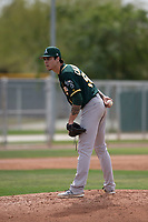 Oakland Athletics relief pitcher Dakota Chalmers (50) looks to his catcher for the sign during a Minor League Spring Training game against the Chicago Cubs at Sloan Park on March 13, 2018 in Mesa, Arizona. (Zachary Lucy/Four Seam Images)