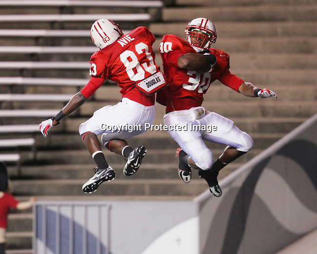 Katy running back Aundre Dean and wide receiver Terrence Avie celebrate a touchdown during the playoffs against Strake Jesuit High School at Rice Stadium, November 17, 2008.