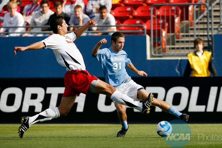 14 DEC 2008:  Omar Gonzalez (4) of the University of Maryland and Brian Shriver (31) of the University of North Carolina battle for the ball during the Division I Men's Soccer Championship held at Pizza Hut Park in Frisco, TX.  Maryland defeated North Carolina 1-0 for the national title.  Jamie Schwaberow/NCAA Photos