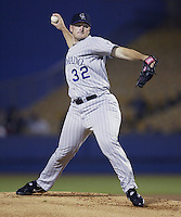 Jason Jennings of the Colorado Rockies pitches during a 2002 MLB season game against the Los Angeles Dodgers at Dodger Stadium, in Los Angeles, California. (Larry Goren/Four Seam Images)