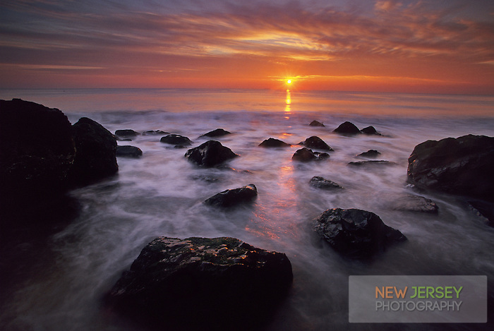 Rock Outcropping, incoming tide at sunrise, Atlantic Ocean and Seabright Beach, New Jersey
