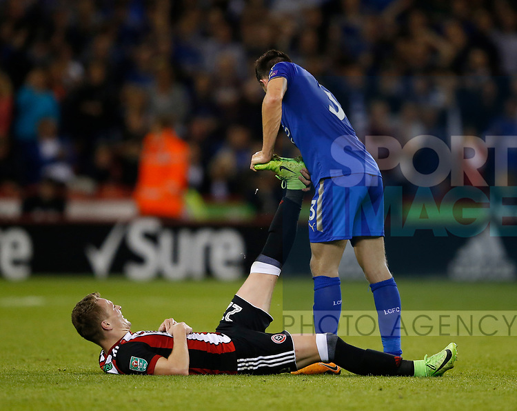 Ben Chillwell of Leicester City haps Caolan Lavery of Sheffield Utd with his cramp during the Carabao Cup, second round match at Bramall Lane, Sheffield. Picture date 22nd August 2017. Picture credit should read: Simon Bellis/Sportimage