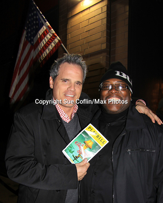 "As The World Turns' Michael Park poses with Dallis who is security (at Lucky Strike) as Michael comes to see Joe West starring in ""A Christmas Story The Musical"" on opening night after party at Lucky Strike on November 19, 2012 at the Lunt-Fontaine Theatre, New York City, New York where the musical is. (Photo by Sue Coflin/Max Photos)"