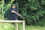 "Stockport , UK . Collect photograph of veterinary surgeon SIMON CONSTABLE carrying a tranquiliser gun taken by "" The Hind's Head "" pub landlord , Stuart Kirkham , who named the deer Ronaldo . A wild deer which was discovered in a park by the busy Manchester Road in Stockport has been rescued after three days . The park was closed and locked by Stockport Council officials on Monday 24th June after the young male started bolting across the playing field and playground and butting its head and antlers against railings . But with the gates locked , the young animal could not escape . For three days local people came out to watch the deer from the fence as it hid in bushes around the edge of the park , occasionally venturing out across the playing pitch and in the direction of the busy A626 road . The landlord at "" The Hind's Head "" pub opposite , Stuart Kirkham , a Manchester United fan , named the beast "" Ronaldo "" because of its red colouring . After three days , with no hope of escape under its own steam and with the park still closed , the RSPCA and council brought in a veterinary surgeon to help . The animal was tranquilised and driven to nearby Reddish Vale Country Park , where he was brought round and released back in to the wild ."