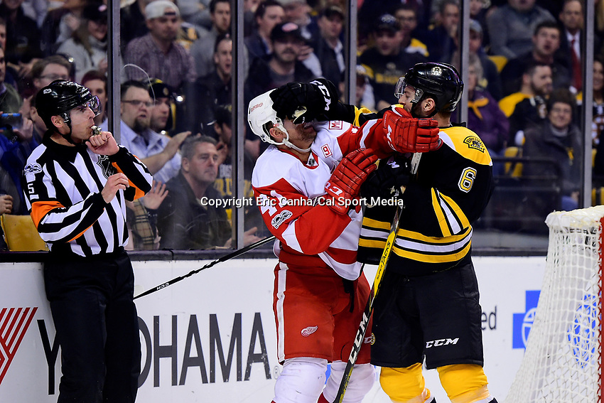 Wednesday, March 8, 2017: Detroit Red Wings center Luke Glendening (41) and Boston Bruins defenseman Colin Miller (6) exchange shoves behind the net during the National Hockey League game between the Detroit Red Wings and the Boston Bruins held at TD Garden, in Boston, Mass. Eric Canha/CSM