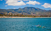 Man fishing on his kayak off the shores of Haleiwa
