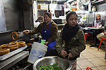 Gyanu Thapa prepares roti at Dhaulagiri Kitchen, a tiny Nepalese restaurant in Jackson Heights, while her daughter Deepa Thapa helps out the kitchen staff. <br /> <br /> Danny Ghitis for The New York Times