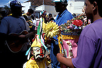 A young boy dressed as one the three kings from the Orient waits to dance with brothers and friends during the Folia de Reis, or Revelry of Kings, in Três Pontas, Brazil. One of Brazil's oldest folk religious festivals, the Folia de Reis takes place on the Feast of the Epiphany, Jan. 6, in the small towns of the interior. Costumed groups parade door to door collecting alms and refreshments.
