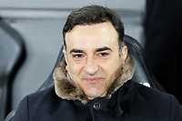 Swansea manager Carlos Carvalhal sits on the bench during The Emirates FA Cup Fifth Round Replay match between Swansea City and Sheffield Wednesday at the Liberty Stadium, Swansea, Wales, UK. Tuesday 27 February 2018