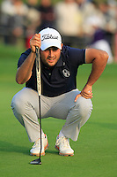 Alexander Levy (FRA) lines up his putt at the 16th green from the crowd during Sunday's Final Round of the 2014 BMW Masters held at Lake Malaren, Shanghai, China. 2nd November 2014.<br /> Picture: Eoin Clarke www.golffile.ie
